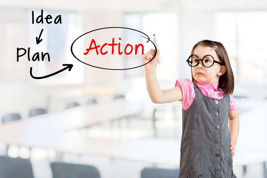 person writing action plan.