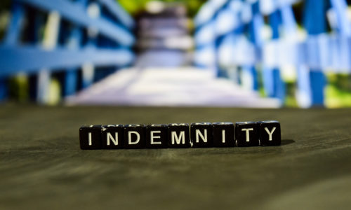 indemnity written in wooden blocks