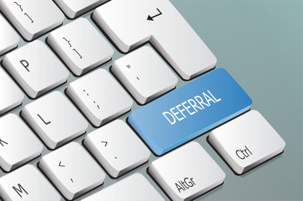 deferral written on the keyboard button