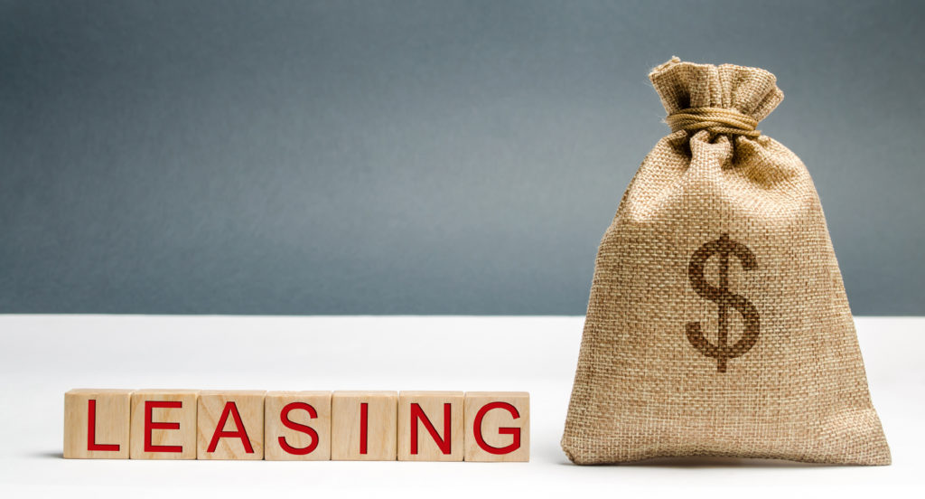 Leasing spelt in block letters beside a sack filled with money
